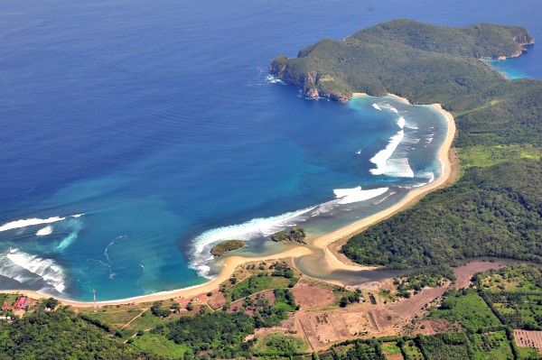 Aerial view of Rantung Beach and Yo Yo's surf break (all the whitewater on the righthand side of the bay). Photo courtesty of Indra